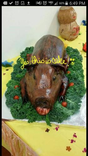 this is a cake luau pig